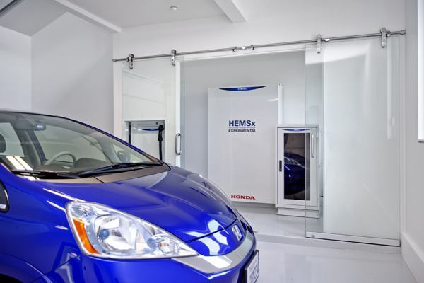 Honda's Home Energy Management System can be used to monitor the home's energy usage, including that of the company's Fit EV direct-current power source for electric vehicles.