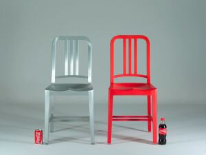 The original Navy Chair, designed in 1944 (left), and the new 111 Navy Chair (right), manufactured from recycled plastic Coca-Cola bottles.