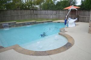 The Comeaux's finished pool with an ADA lift that Cody Pools provided free of charge.
