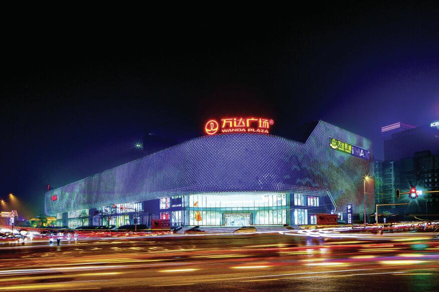 Opened in September 2013, this 860,000-square-foot luxury shopping plaza in Wuhan, China, features a façade illuminated with 3.1 million LEDs housed in 42,333 stainless steel spheres. The façade has no right angles, but rather wraps its way around the five-story building. Silver by day and pulsing with color at night, the fixtures cluster above entrances to steer wayfinding.
