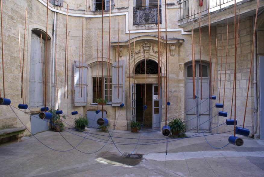 Paris-based Atelier Senzu installed a giant game of telephone in a courtyard in Montpellier.