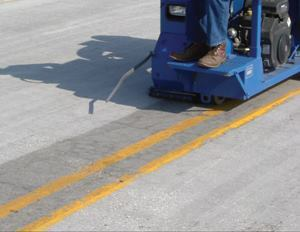The project started in the morning by abrading the surface so the coasting system would bond.