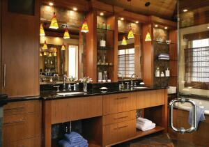 This master bath design by Holly Rickert, a first-place winner in the National Kitchen & Bath Associationís design competition, features cherry cabinets, slate-look porcelain floor tile, glass-tile accents, black granite countertops, and a heated floor.