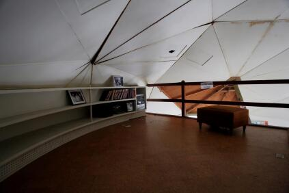 The dome's loft space, a study with a built-in bookcase, in recent years.