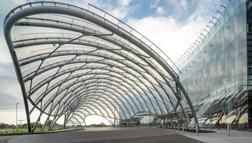 The undulating form of the canopy contrasts with the curve of the 300 ...