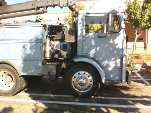 This early 60's White Compact model was configured as a welding truck, with a diesel stick welder mounted directly behind the cab.