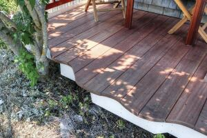 My customer wanted to increase the width of her 3-foot- wide porch by more than a foot, plus add a wavy outer edge that would meander around a large Rose O'Sharon shrub and mimic the winding curves of her cottage garden