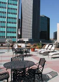 The façade and rooftop deck furnishings of Dallas' Post Wilson Building hint of Paris.