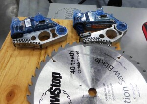 A new SawStop cartridge (left) and one that has been destroyed (right) while engaging with--and stopping--a blade.