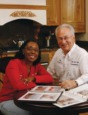 Sonia Santos and Don Van Cura of Don Van Cura Construction, in Chicago, show off the albums that office manager Santos creates for clients. With before, during, and after photographs, the albums are a marketing tool that grateful clients like to share with visitors.