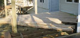 The 2x6 decking was face-screwed at a 45-degree angle to the house and framing both for appearance and to prevent lateral sway.