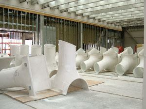 "A tubular unit called a ""soffitto,"" constructed of glass-fiber-reinforced gypsum diffuses and directs light into the galleries."