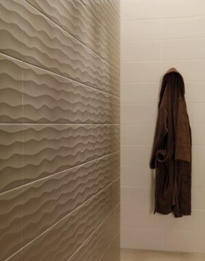 "The Imazi series of wall tiles by Vives alludes to the contours of the Sahara Desert in a palette of grays and earth tones.    8"" x 20"";  vives.es"
