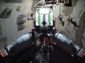 Ready-mix trucks deliver an average of 1300 cubic yards of concrete to the trailer pump for each floor.