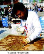Ehrenzweig adds the finishing touches to his demo piece at Artistry in Concrete 2004.