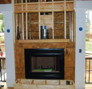 Figure 1. So-called zero-clearance fireplaces do in fact require some clearance to combustibles but so little that wood-framed chases are typical.