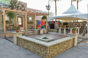 The Butterfield Color exhibit featured a residential facade and a variety of outdoor spaces constructed by the company's sales staff using a broad range of its products.