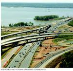 Looking west at the I-295 interchange, the bridge construction can be seen in the background. All bridge structures had to be reconstructed because of the wider Beltway footprint. The concrete slab on the new bridge is 110 feet wide. When this photo was taken, in September 2005, the new structure was about 40% complete.