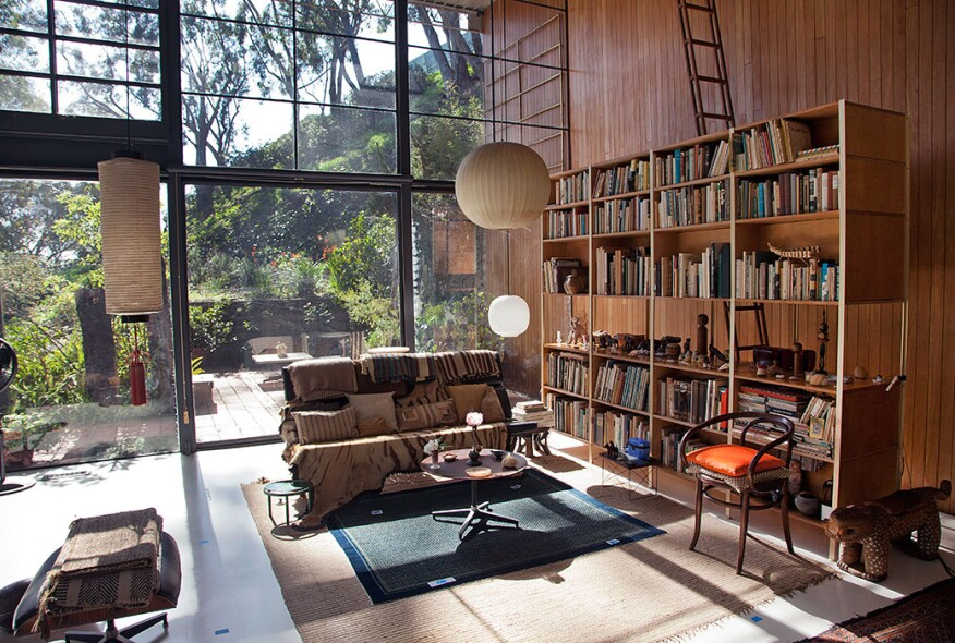 The restored tallowwood wall paneling in the Eames House living room