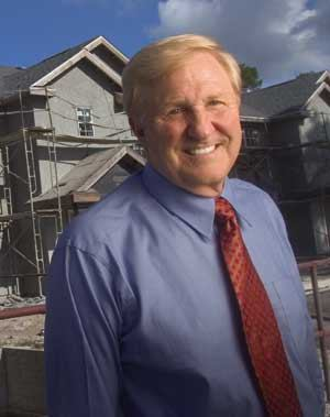Bob Fleckenstein, president of Summit Contractors Inc., stands in front of Madison Woods Apartments, a 240-unit building under construction in Jacksonville, Fla.