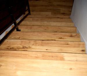 A Step Up: The show house's stair way features engineered reclaimed plank hickory flooring from Restoration Timber.