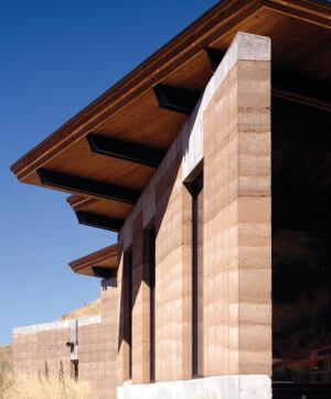 The 18-inch-thick rammed-earth wall offers thermal benefi ts, as well as acoustic protection from a major highway at the bottom of the hill.