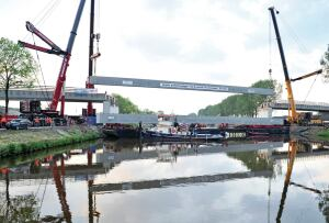 One of 15 mega prestressed beams is installed to form the main span of the new bridge in Zuidhorn.