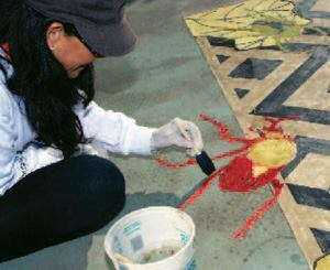 Kristi Hughes works on her design at the Artistry in Decorative Concrete demonstration at World of Concrete.