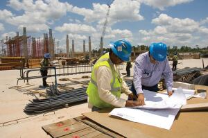 Crew members review plans during construction of the Conroe ISD Woodforest Stadium & Natatorium in Shenendoah, Texas.