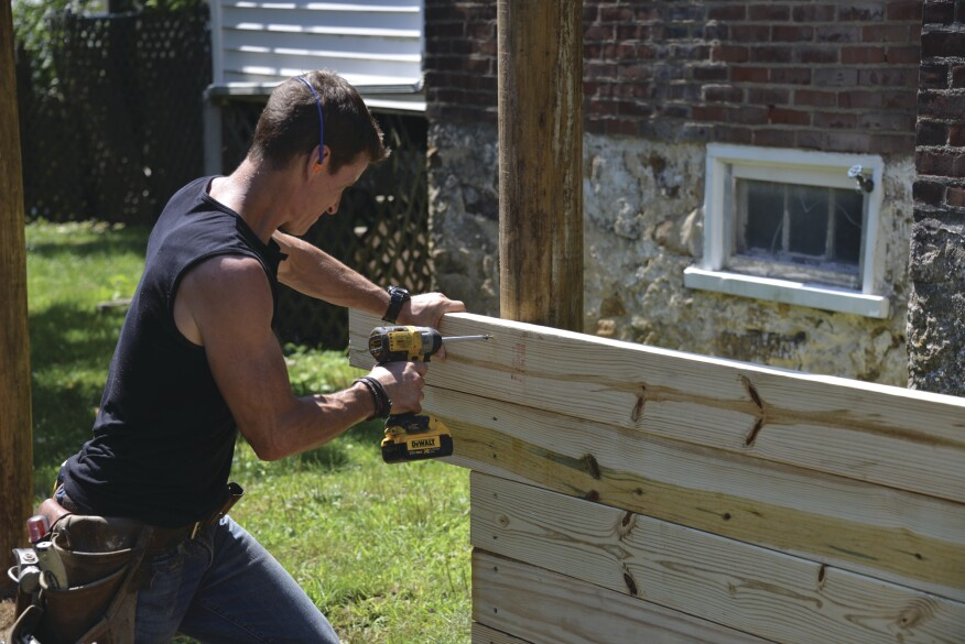 The 2x6 PT planks are fastened to the posts with 3-inch-long structural screws.
