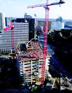 Depending on the size of the building, a placing boom often can provide concrete to the entire floor from a central location. Photos: