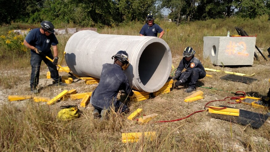 Rinker Materials Concrete Pipe Handling : Firefighters simulate rescue techniques with donated