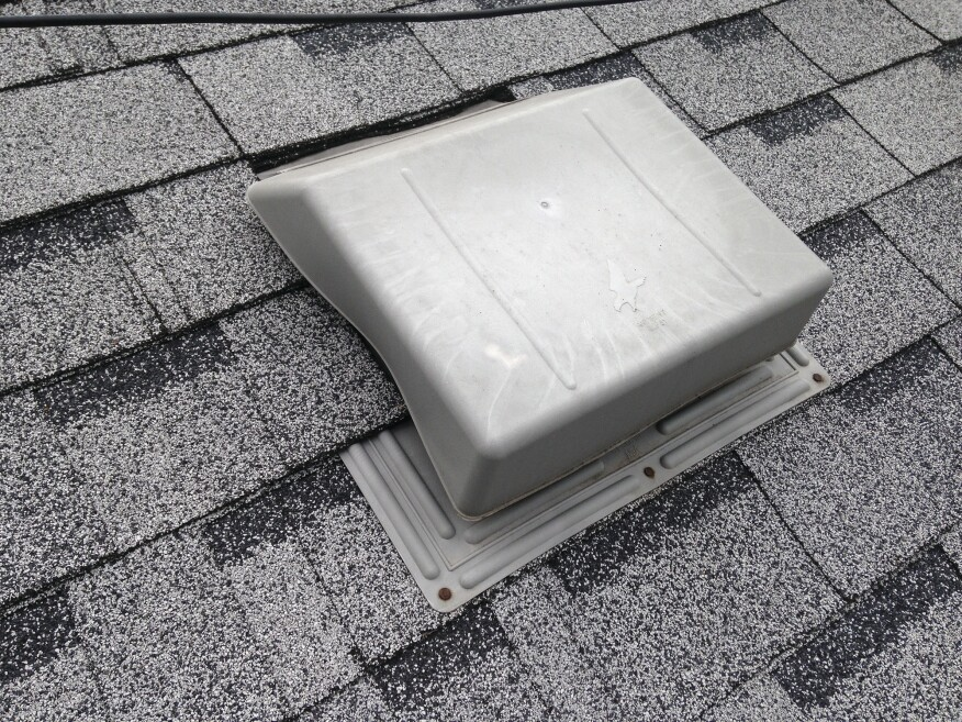 Also shown here is a very poor installation of a self-flashing roof vent. The shingles were not cut carefully around the vent but were instead jammed up against the vent, distorting the hood.