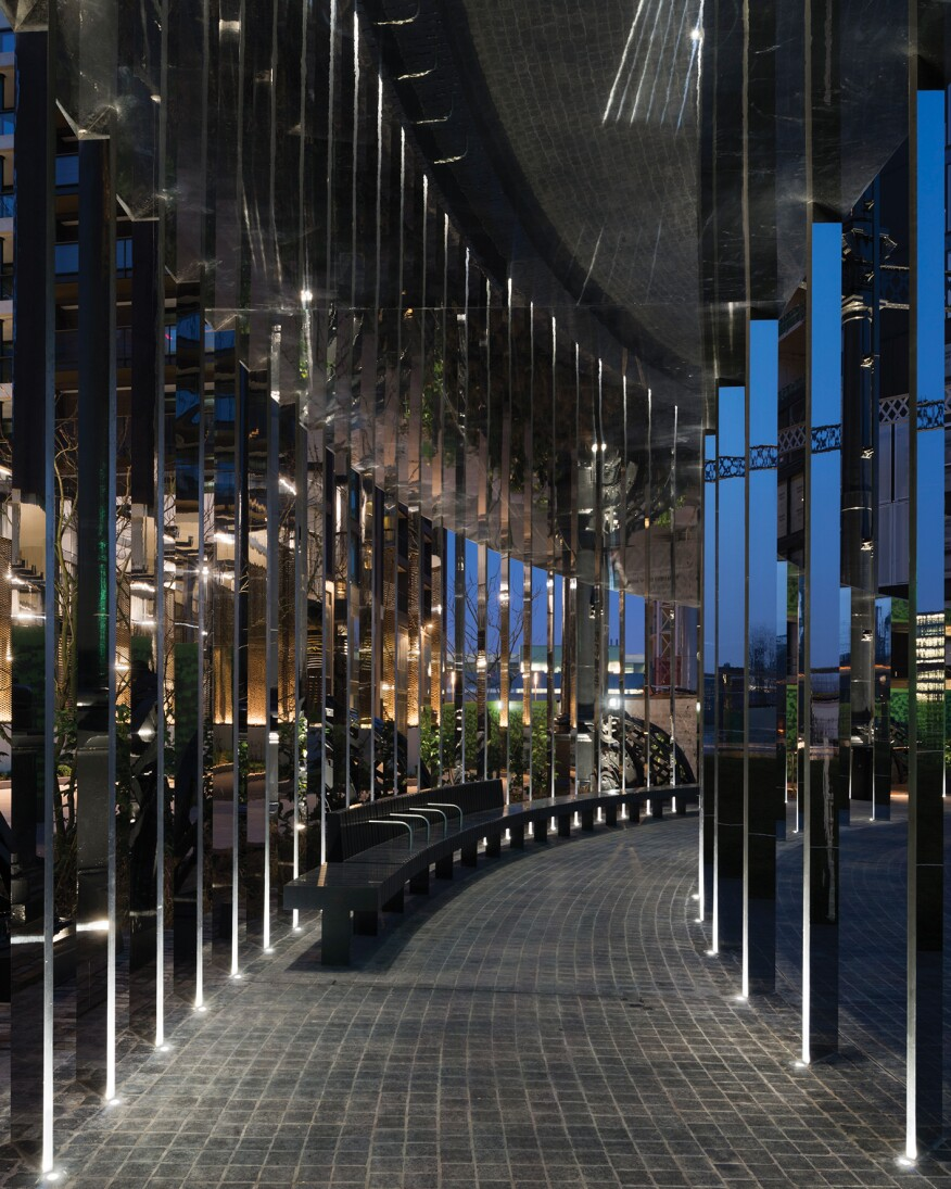 Separate LED uplights, one type for the canopy and another for the gasholder, highlight the two different structures; the luminaires are programmed via a lighting control system to sequence through an illumination cycle to animate the park and surroundings while engaging visitors.