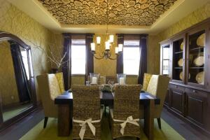 Green Builders' model homes are decorated with eco-friendly finishes and furnishings. The ceiling treatment in this dining room is made of salvaged tree branches.