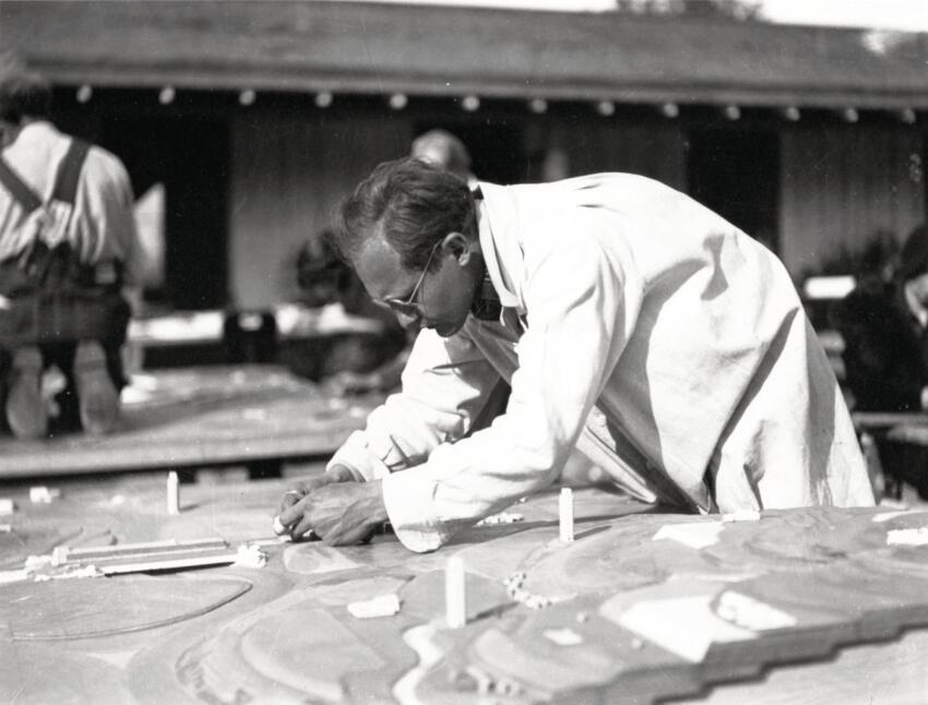 A Taliesen fellow in Chandler, Ariz., works on a 1935 model of Wright's Broadacre City development scheme, which sought to bring urban density to suburbia.