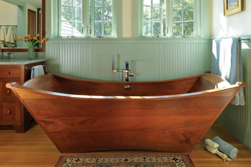 The custom tub is the centerpiece of the bathroom in this Arts and Crafts-inspired residence