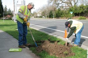 "From left: Andy Martinez and Rick Oliva, senior maintenance workers and irrigation specialists for the City of Santa Rosa Recreation & Parks Department, work on repairs to make the city's reclaimed water irrigation system more efficient to control runoff. ""Zero runoff and/or over spray is our goal,"" says Parks Superintendent Lisa Grant. Photo: Jennifer Tuell"