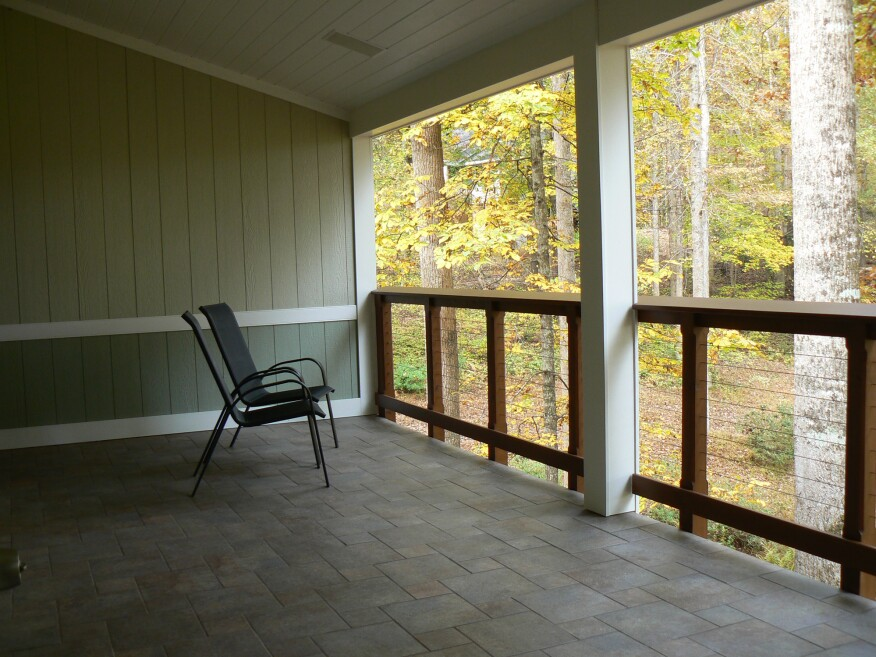 Even after four years of use, the porch floor looks as good as the day the tile was installed.