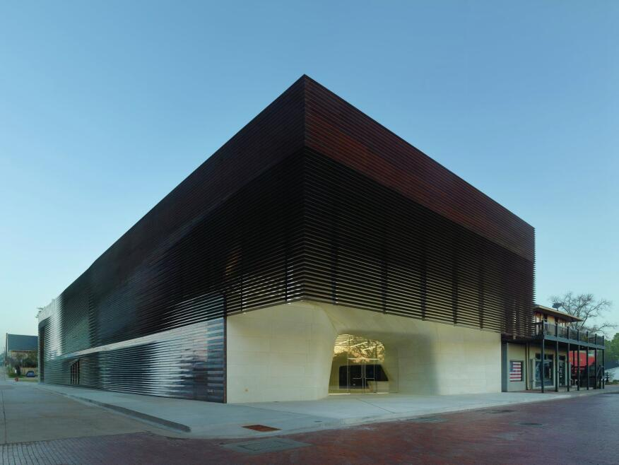 Clad in copper louvers, the open-air 'porch' at the front of the structure is intended as a modern interpretation of the porches and balconies of the surrounding structure, such as the Pioneer Pub next door.