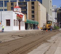 After the streets were pulverized, road builder Sierra Nevada Construction scalped  the top 6 inches to make room for new asphalt to be placed up to the  existing grade.