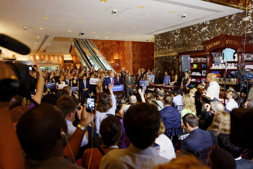 The President at a campaign event at Trump Tower in 2015, when the Trump Store still occupied the space reserved for a public bench