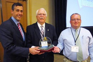The New Hampshire DOT is honored with FP2 Inc.'s James B. Sorenson Award for Excellence in Pavement Preservation. At Nov. 12 presentation are, from left, NH DOT Commissioner Chris Clement; FP2 executive director Jim Moulthrop; and Eric Thibodeau, chief, pavement management for NH DOT.