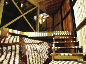 A stair runs down the inside of the skirting from the lower deck to the dock.