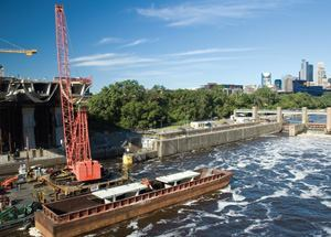 A barge on the Mississippi River transports precast segments to the jobsite.