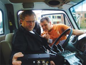 Mechanic Wayne Schneider points out settings on a computerized spreader control during a course he helped develop at the 2010 Snow School in Alliston, Ontario. Photo: Wellington County, Ontario
