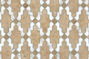 Navarra, a natural stone and ceramic waterjet mosaic shown in Fireclay Spanish Moss, Lavigne honed and Calacatta Tia polished, is part of the Miraflores Collection by Paul Schatz for New Ravenna Mosaics.