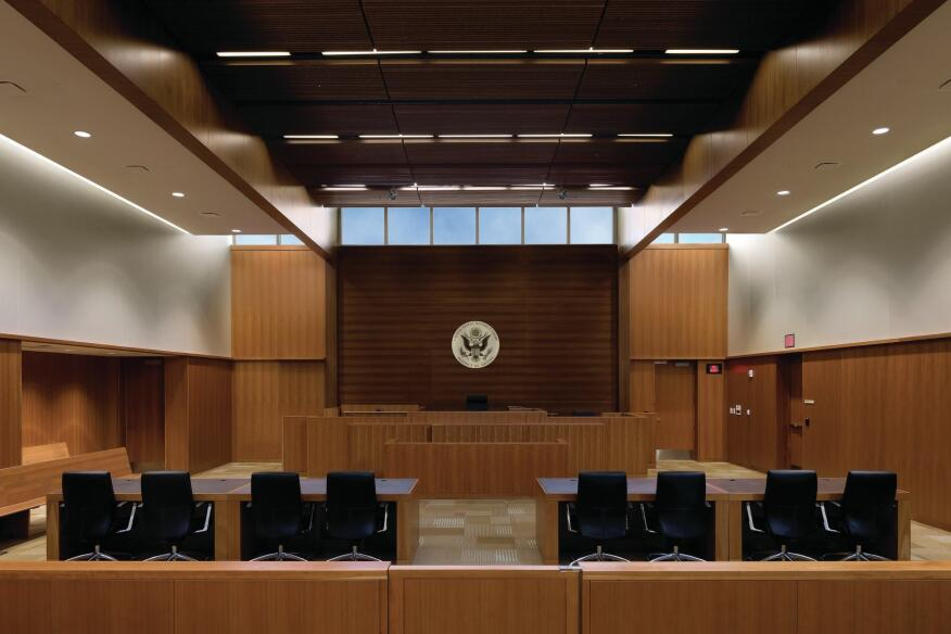 The courtrooms receive natural light through clerestory windows, which can be shielded by automated blinds. Ceiling panels from Architectural Components Group modulate the acoustics.