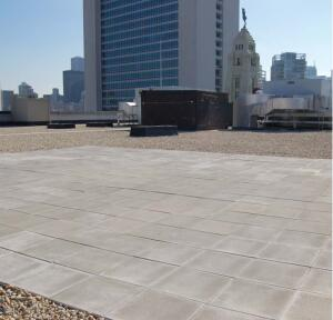 A roof system featuring concrete pavers and ballast in Chicago now is accepted by Chicago Code as a cool-roof system.