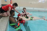 Gym Class Heroes: Kari Winkler, PE department chair at the Eau Claire Area School District in Wisconsin, instructs a lifeguard course at Memorial High School. Students earn PE credit for taking the course.